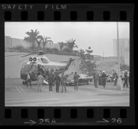 President Johnson and Lynda Bird exit helicopter in parking lot at Century Plaza. B. 1967.