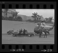 Presidential motorcade begins to assemble near Century Plaza as Lyndon and Lynda Bird Johnson have arrived by helicopter, 1967.