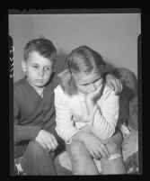 Stanley Lyon and Barbara Fiscus wait to hear the fate of their cousin and sister, respectively, Kathy Fiscus, 1949.