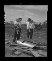 Mrs. William and Richard Houle and their children look at pieces of the pipe in which Kathy Fiscus had been trapped, 1949.