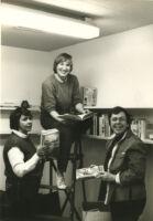 Connexxus office: Del Martinez, Lauren Jardine, June Mazer in library