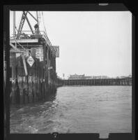 Santa Monica Pier as seen from the ocean. A. 1973.