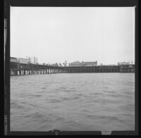 Santa Monica Pier as seen from the ocean. B. 1973.
