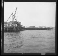 Santa Monica Pier as seen from the ocean. C. 1973.