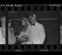Norman Chandler and bride, the former Jane Emilie Yeager, after their marriage ceremony. A. 1976.