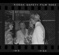 Norman Chandler (groom) with Jane Emilie Yeager (bride) and his mother Marylin Brant (center-left) after wedding, 1976.