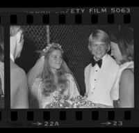Norman Chandler and bride, the former Jane Emilie Yeager, after their marriage ceremony. C. 1976.