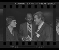 Hugh Hefner (left), Mayor Tom Bradley (center) and Los Angeles Times Publisher Otis Chandler at reception for Freedom of Press exhibit, Los Angeles, 1980
