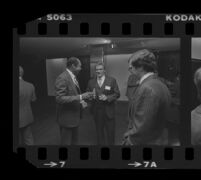 Tom Bradley (left) talks with Otis Chandler during reception for Freedom of Press exhibit, 1980.