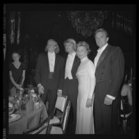 Otis Chandler (right) with sons, including Norman Brant Chandler (2nd from left), and wife, Marylin Brant at the Las Madrinas Ball, 1973.