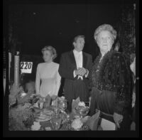 Otis Chandler (center) with with Marilyn Brant (left) and mother Dorothy Chandler at Las Madrinas Ball, 1973.