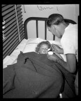 Diane Carol Harris is treated for broken arm at Van Nuys Receiving Hospital after surviving plane crash, 1949.