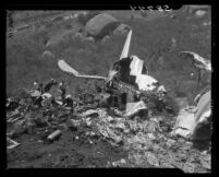Tail section of C-46 rises above wreckage of Standard Airlines crash, 1949.