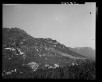 Wreckage of Standard Airlines C-46 crash sits on hillside, 1949.