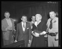 Barbara Payton and attorney Milton Golden (center-left) at the actress' arraignment for check fraud, Los Angeles, 1955