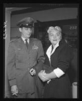 Barbara Payton and former husband Capt. John Payton after custody agreement regarding son, Los Angeles, 1955.