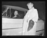 Barbara Payton in car on her way to board plane, with Mrs. Kent Modglin, 1951.