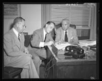Franchot Tone signs waiver as District Attorney S. Ernest Roll (right) and personal attorney Henry Herzbrun (left) look on, Los Angeles, 1951