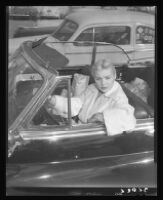 Barbara Payton in car outside of market on Sunset Blvd., 1951.