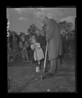 Clarence A. Dykstra, UCLA Provost, and first-grader Jeannie Morgan break ground for University Elementary School at UCLA, 1949.