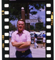 """Vin Scully, Dodgers announcer, stands in front of """"Vin Scully Way"""" street sign at Dodgertown, in Vero Beach, Florida, during Spring Training, 1985."""