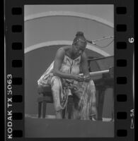 Nina Simone sits at piano bench during Playboy Jazz Festival performance at the Hollywood Bowl, 1986.