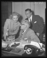 Barbara Payton with Attorney Milton Golden (right) and Superior Judge Elmer Doyle (center) after receiving final papers for her divorce from Franchot Tone, Los Angeles, 1953