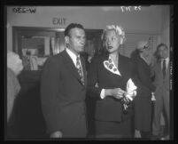 Barbara Payton with Attorney Milton Golden at Los Angeles Court House during alimony battle with Franchot Tone, Los Angeles, 1952
