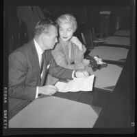 Barbara Payton (with Attorney Milton Golden) in court, arraigned on bad check charges, Los Angeles, 1955.