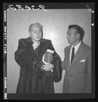 Barbara Payton (with Attorney Milton Golden) receives a delay in check-fraud case due to illness, Los Angeles, 1955
