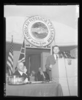 Nelson Rockefeller speaks at AFL convention as union President George Meany looks on, 1963.