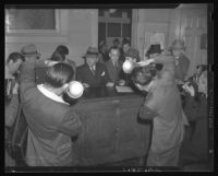 William Bioff (center) being photographed by news photographers, 1939.