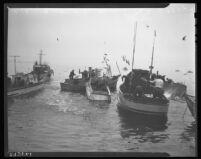 Fisherman flinging fish on fishing boats at Santa Monica, 1942.