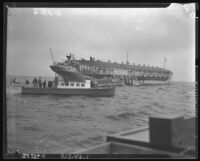 Gambling boat, Rex (larger), resists boarding from California Fish and game Commision boat, Bonita (smaller) off Santa Monica, 1939.