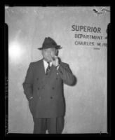 William Bioff smoking in front of Superior Court where he was indicted for tax evasion, Los Angeles, 1939