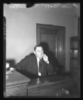 William Bioff on the stand, smoking, during testimony, 1939.