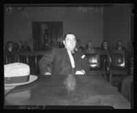 William Bioff sitting at defendant's table during court proceedings, Los Angeles, 1939.