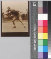 Ralph J. Bunche holding basketball