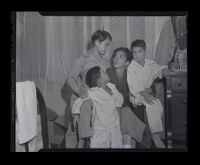 Yay Panlilio, Filipina-American and Phillipine guerilla leader, with her children, 1945