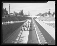 Motorcade led by motorcycles during the dedication of Arroyo Seco Parkway, Los Angeles, 1940