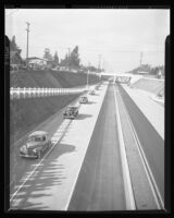 Automobiles travel down Arroyo Seco Parkway at the highway's dedication, Los Angeles, 1940