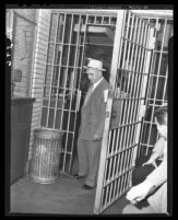 Tony Cornero, gambling ship operator entering jail cell, 1946.