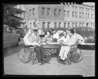 Paraplegic students sign up for classes at UCLA, 1949.
