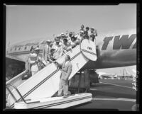 Chancellor Raymond B. Allen of UCLA says goodbye to students bound for India, 1953.