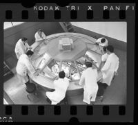 UCLA medical students observing an operation from above through dome, 1965.