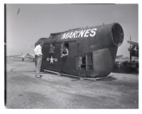 Marine helicopter fuselage salvaged from mountaintop, 1953.
