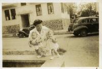 Grandmother holding her grandchildren