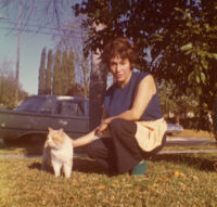 Woman with cat on yard