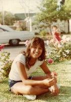 Teenage girl holding a rose
