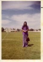 Teenage girl standing in school yard